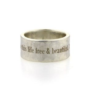 A silver ring laser engraved around the outside