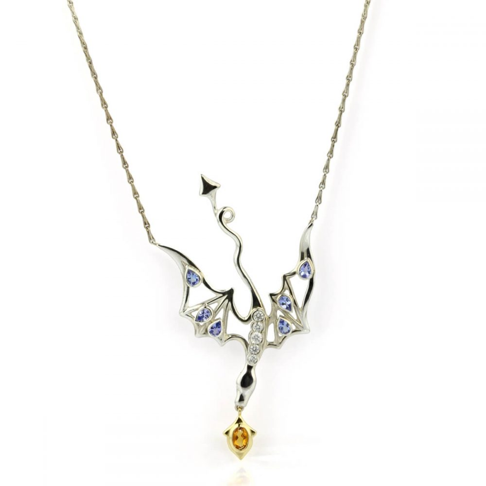 silver and gold dragon pendant