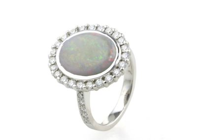 opal and diamond halo engagement ring